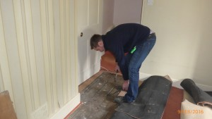 Lifting the floorboards in a damp and timber inspection.