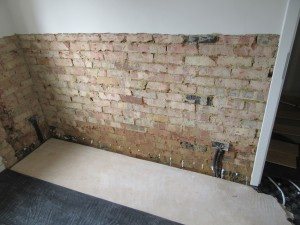 The injected chemical damp proof can clearly be seen at the bottom of the wall.