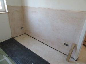 The wall has been plastered with a sand and cement render incorporating a waterproof additive.
